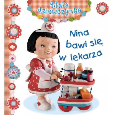 Mała dziewczynka Nina bawi się w lekarza Wydawnictwo Olesiejuk